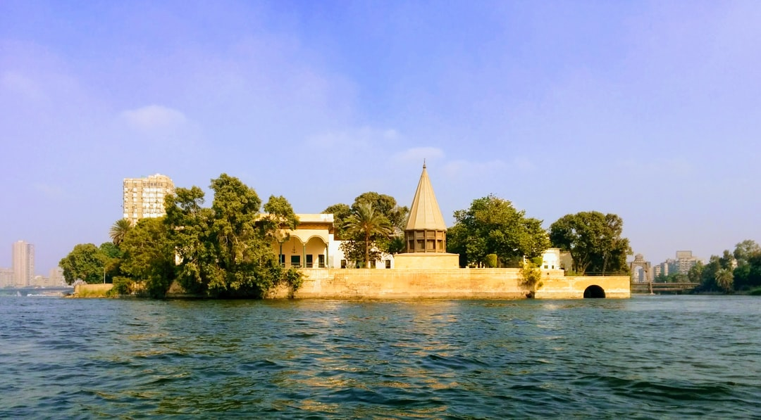 a view from a kayak on the Nile of Manesterly palace and the nilomoter on the southern tip Manial island, Old Cairo, Egypt
