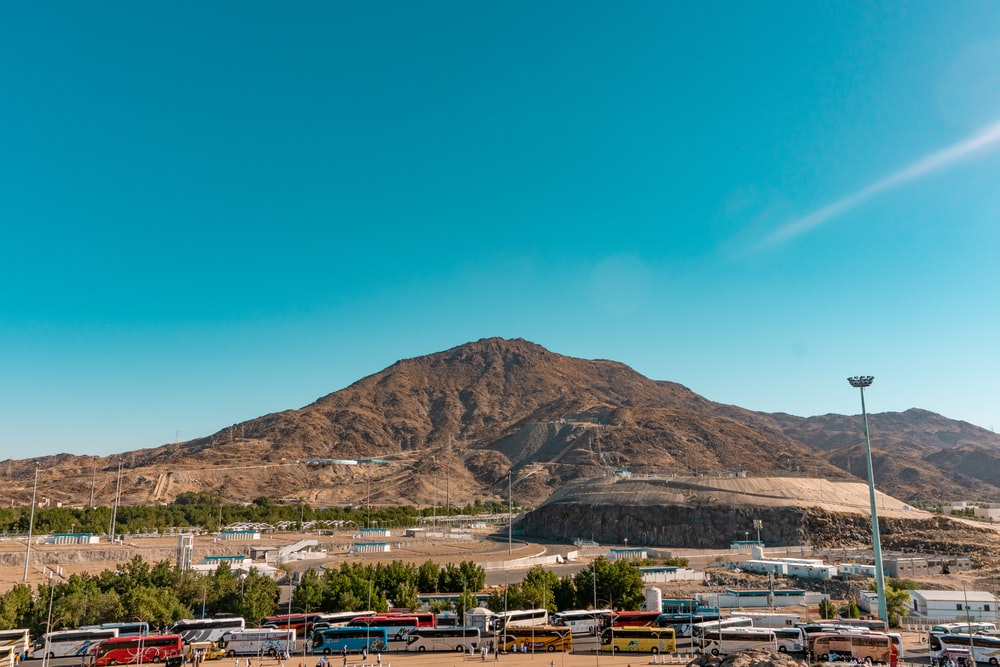 brown mountain under blue sky during daytime