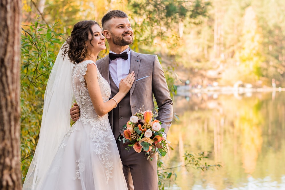 man in gray suit and woman in white wedding dress