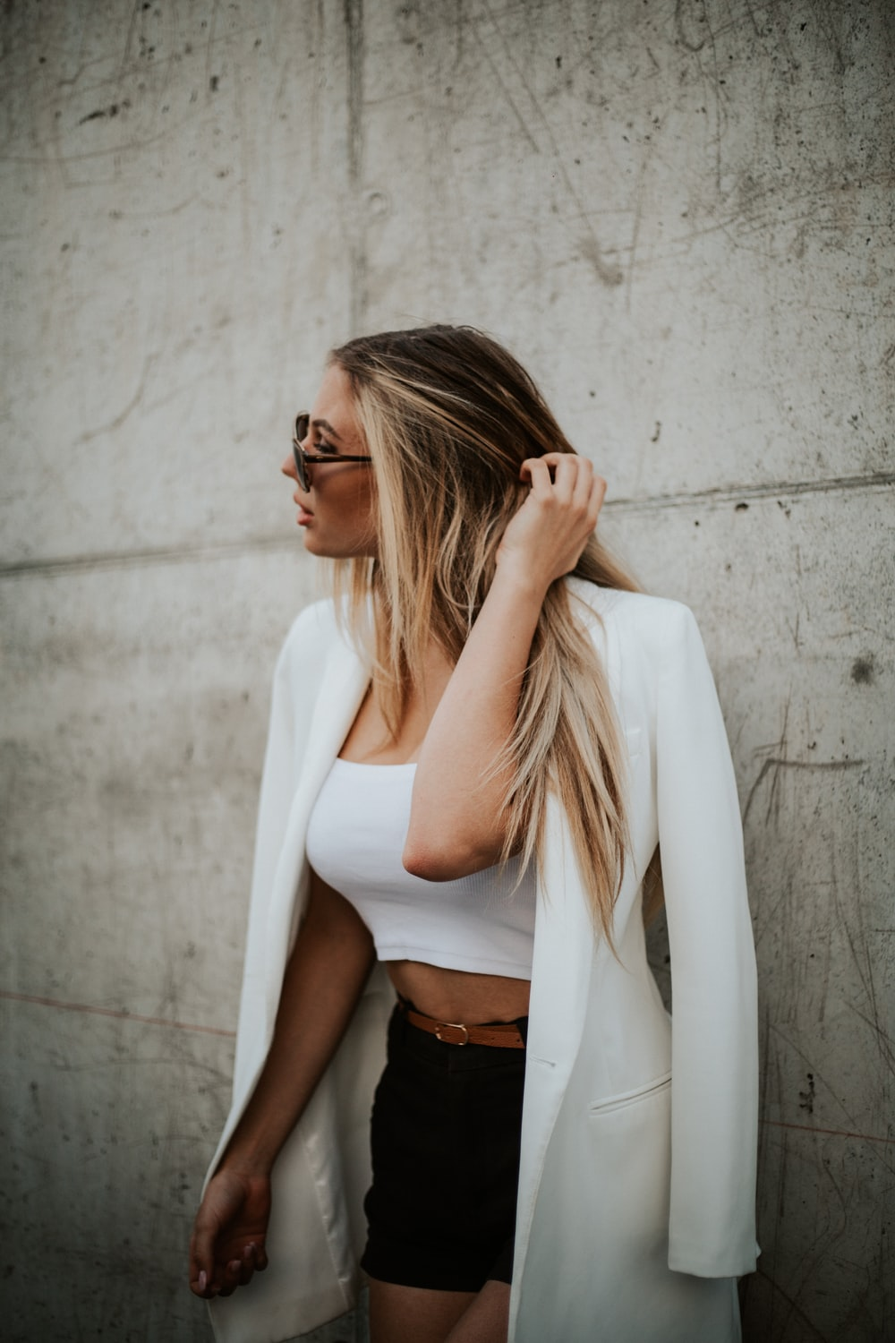 woman in white long sleeve shirt and black skirt