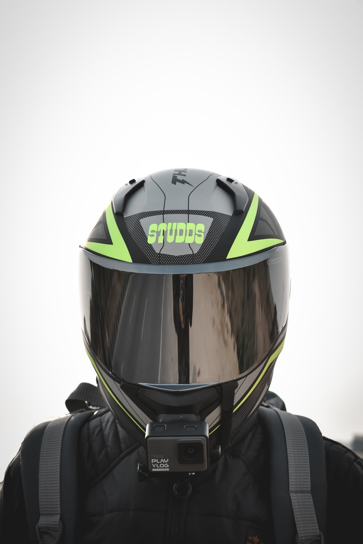 black yellow and green helmet