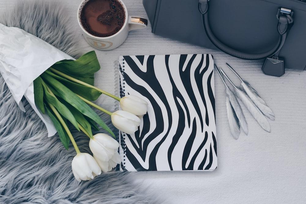 white garlic on black and white zebra print textile