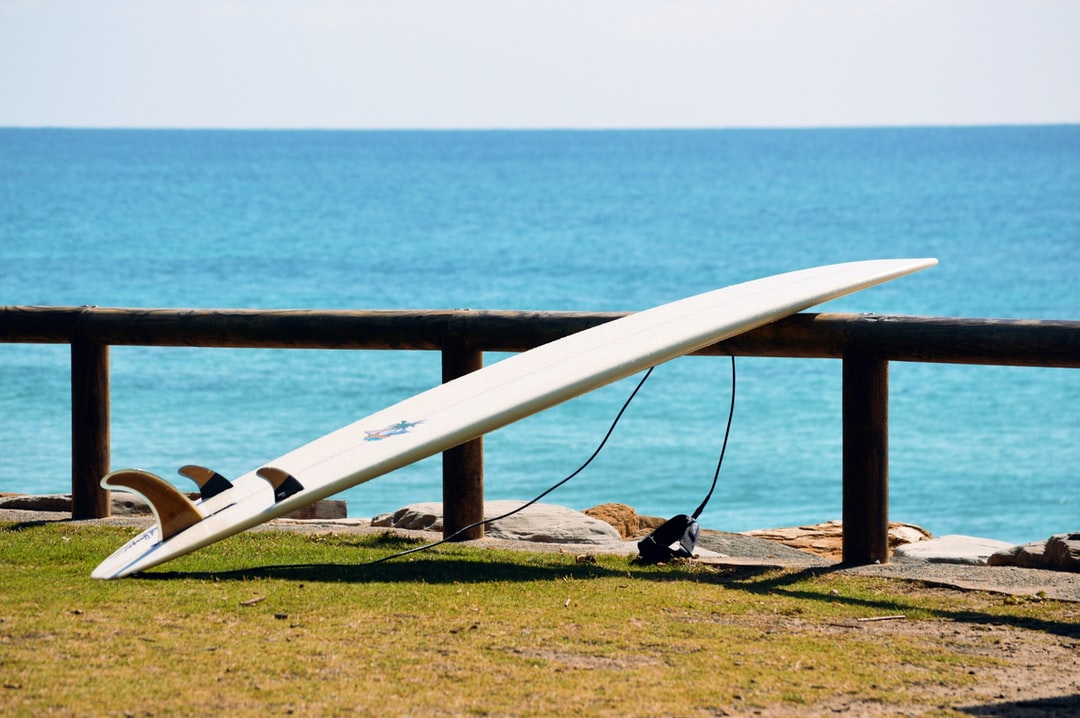 Surf Board Leaning Against Fence Beside the Beach on the Sunshine Coast, Queensland, Australia.