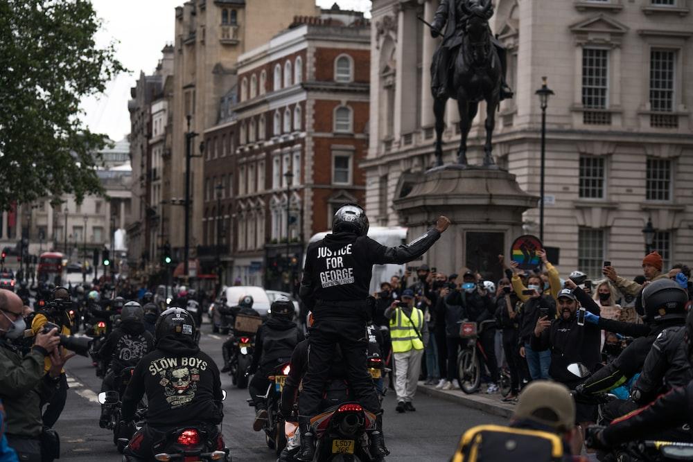 people in black helmet riding motorcycle on road during daytime