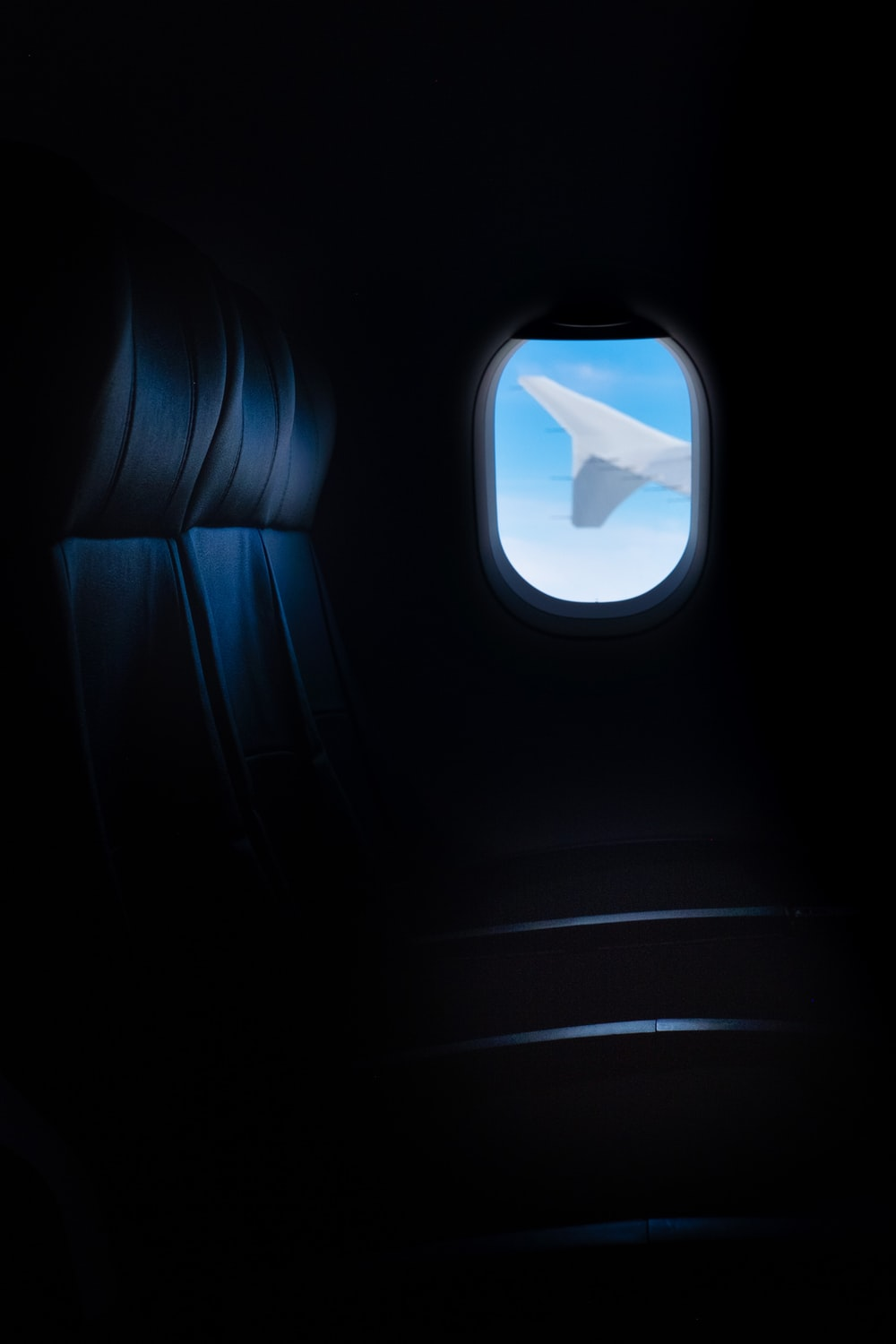 airplane window with white clouds