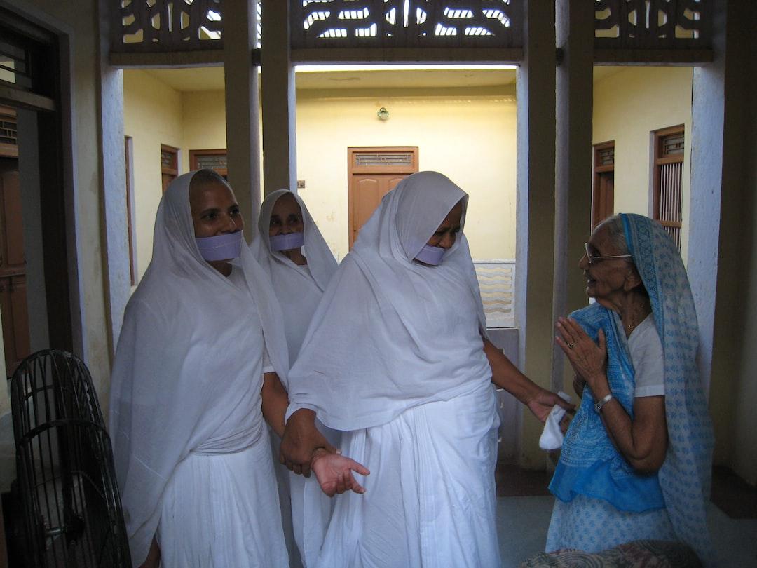 Sadhvi Pramukha (head nun of the Jain Shvetambar Terapanth tradition) graces the home of a lay follower and showers her compassion.