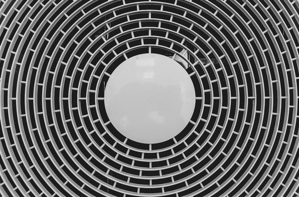 black and white round illustration