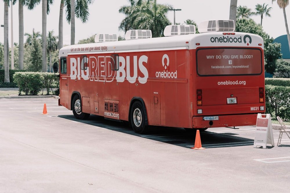red and white coca cola bus on road during daytime