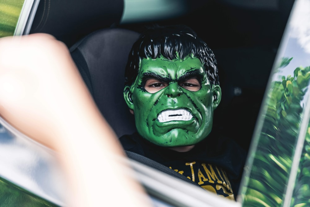 person with green face mask