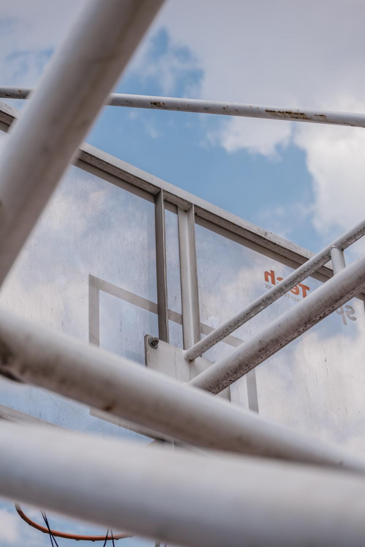white metal railings under blue sky during daytime