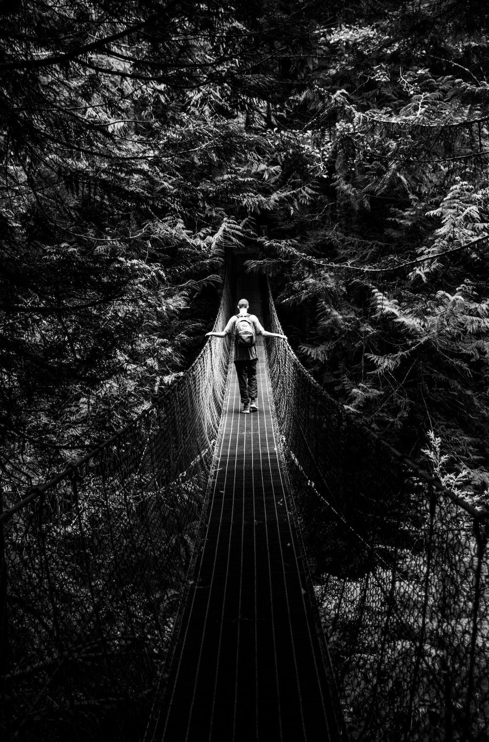 grayscale photo of hanging bridge