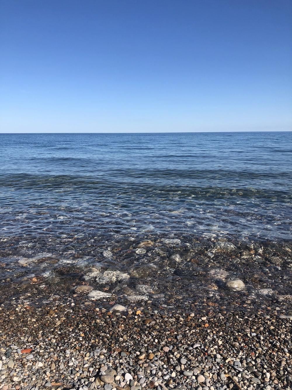 blue sea under blue sky during daytime
