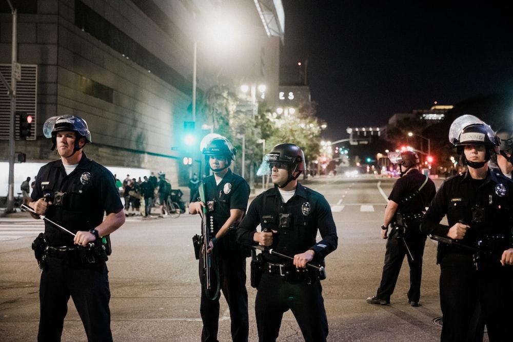 man in black shirt and pants holding black dslr camera
