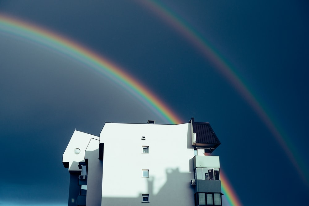 white concrete building with rainbow