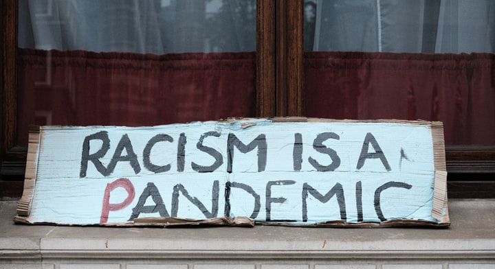 Will Racist Reactions To Covid-19 Deepen The Divide Between Races In International Politics?