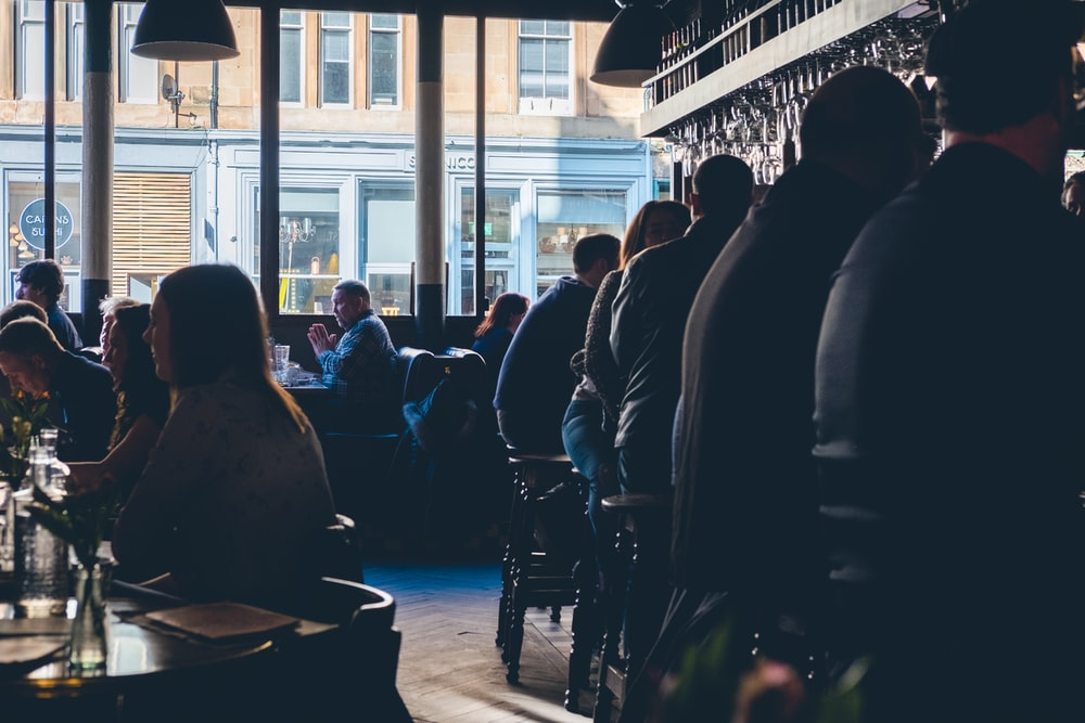 people sitting on chairs near glass window during daytime