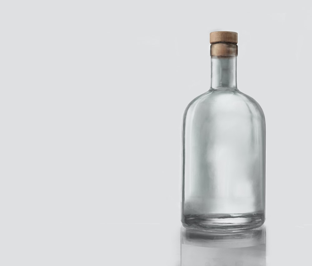clear glass bottle with white background