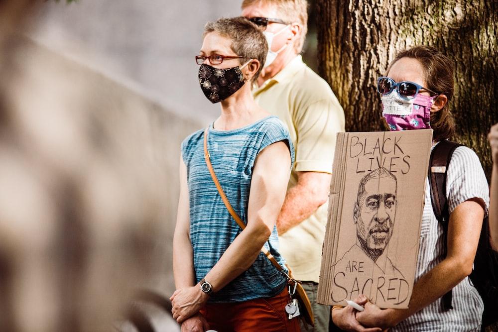 man in blue crew neck t-shirt wearing black sunglasses