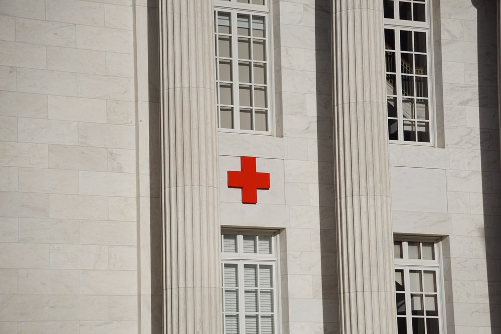 red cross on white concrete building