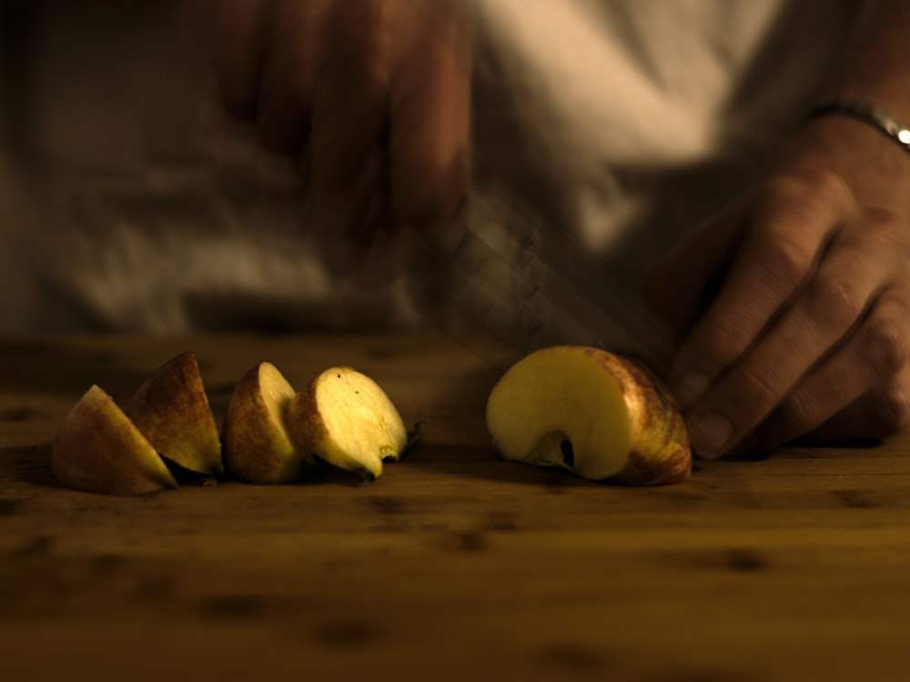 sliced apple on brown wooden table