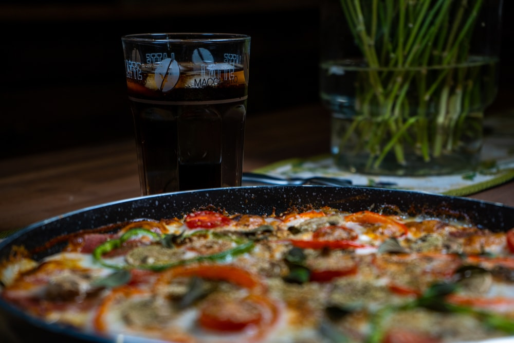 pizza on black ceramic plate