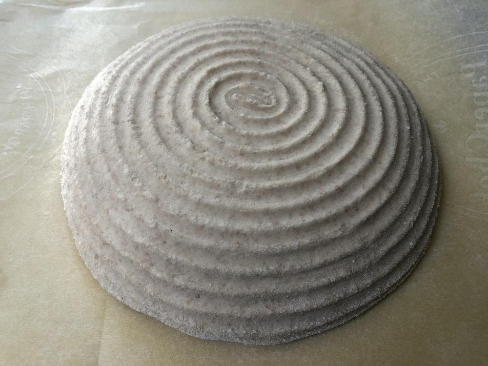 brown round textile on white textile