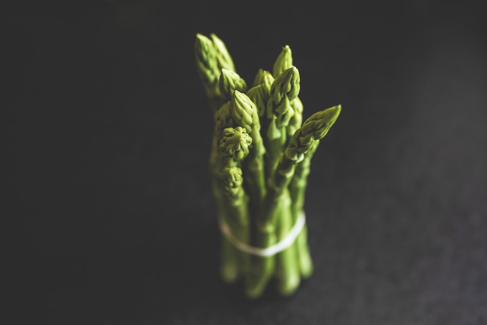 green vegetable on black textile