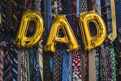 yellow blue and red hanging decor father's day teams background