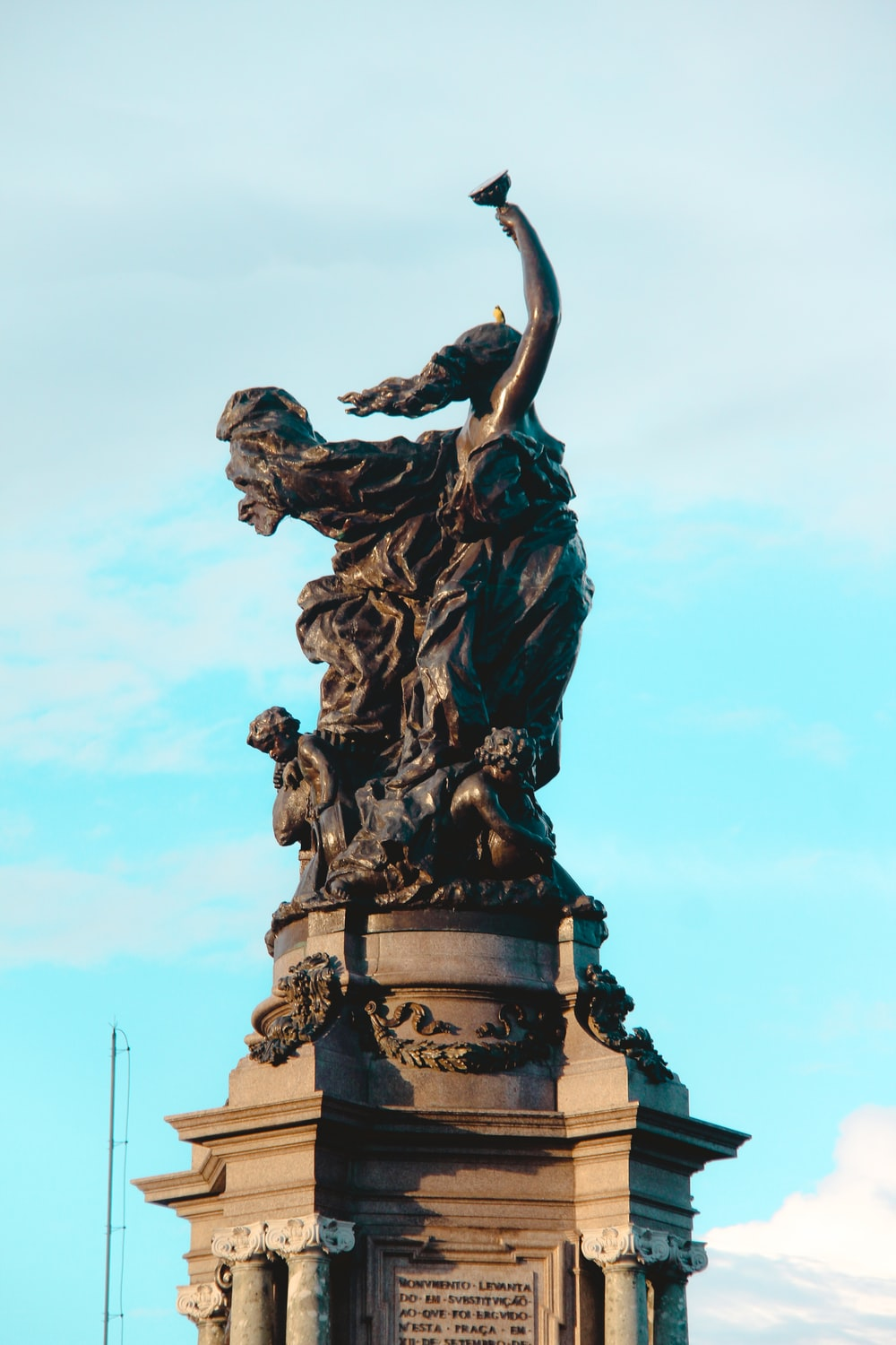 black statue of man with wings