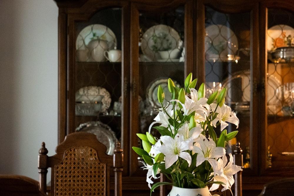 white and green flower in white ceramic vase