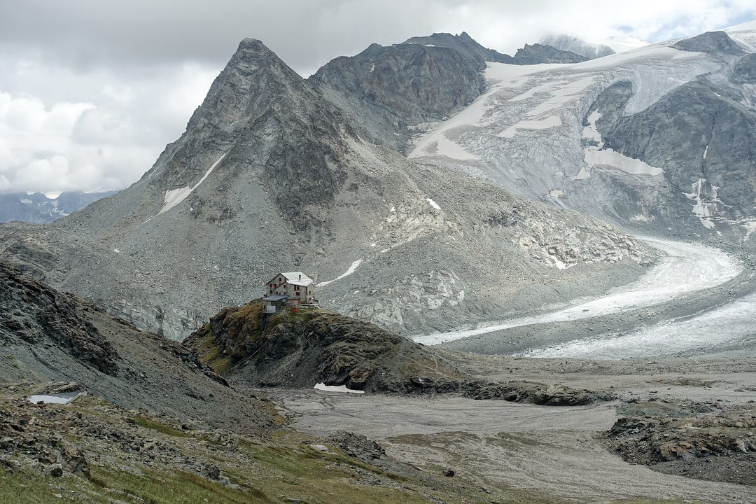 The wonderfully situated Cabane des Dix mountain refuge in The Alps, Switzerland, with Mont Blanc de Cheilon and its glacier in the background