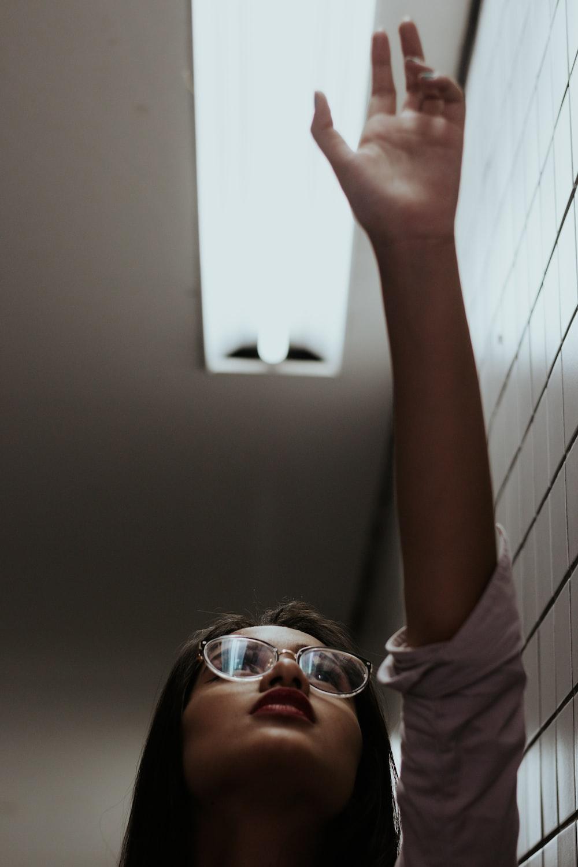 woman in white shirt wearing sunglasses