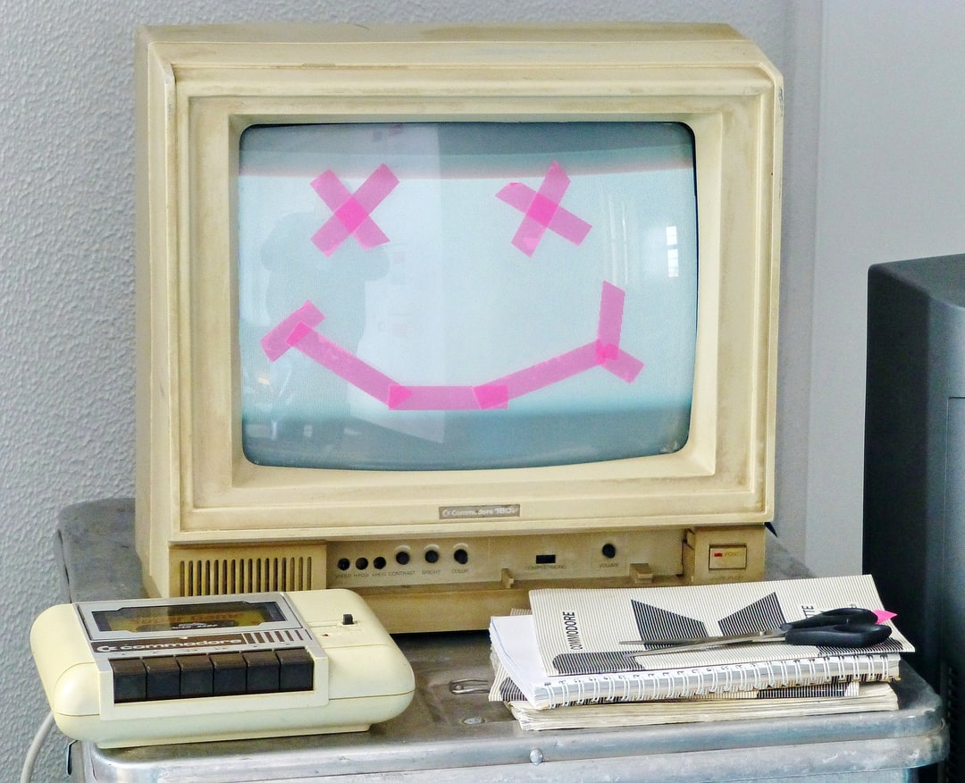 Give your computer a smile and see what comes back :-) Photo of an old Commodoe monitor with a smiley, also a datasette and old insturctions. Perfect picture for every helpdesk.