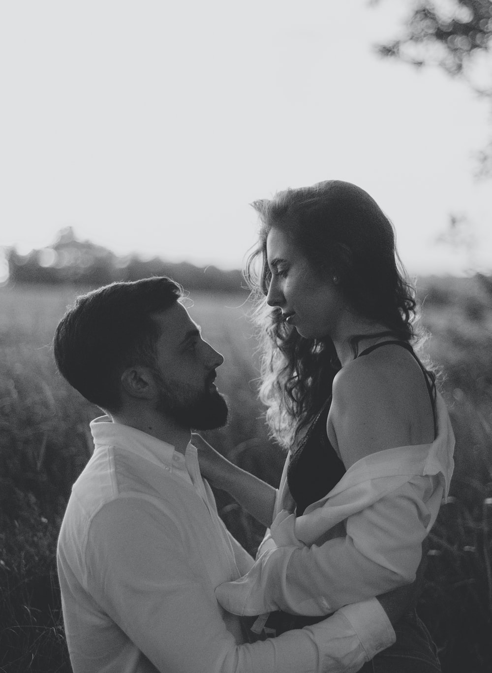 grayscale photo of couple kissing