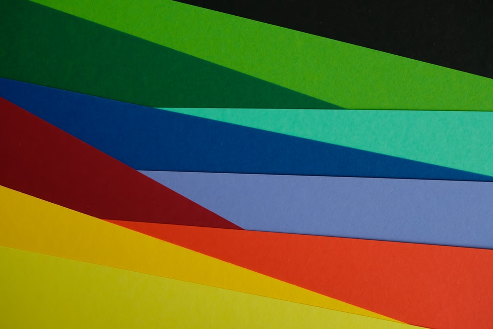 green yellow red and blue striped textile