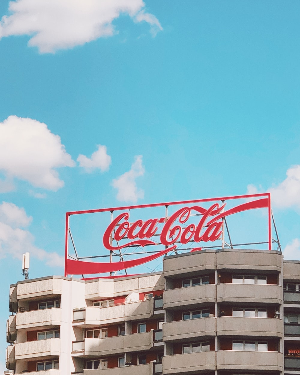 red and white coca cola signage