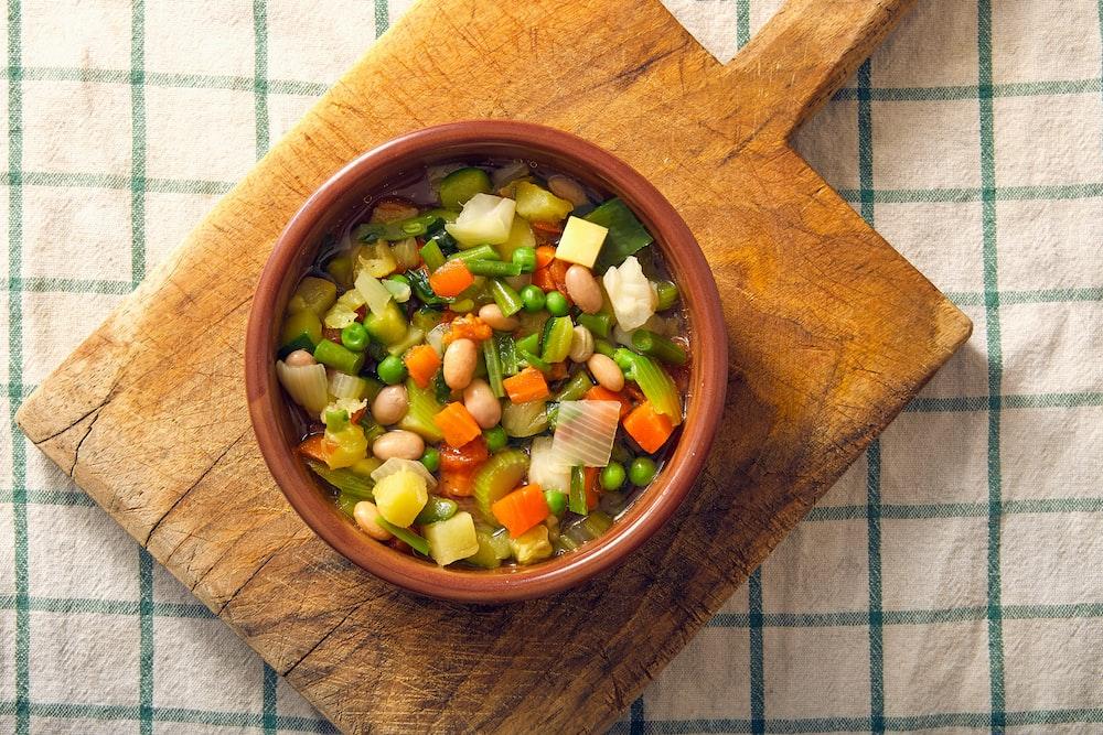 sliced vegetables in brown wooden bowl