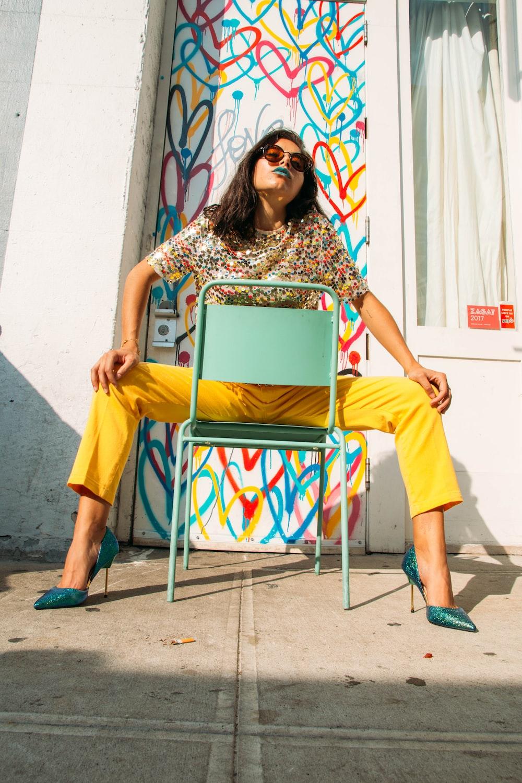woman in yellow sleeveless dress sitting on yellow chair