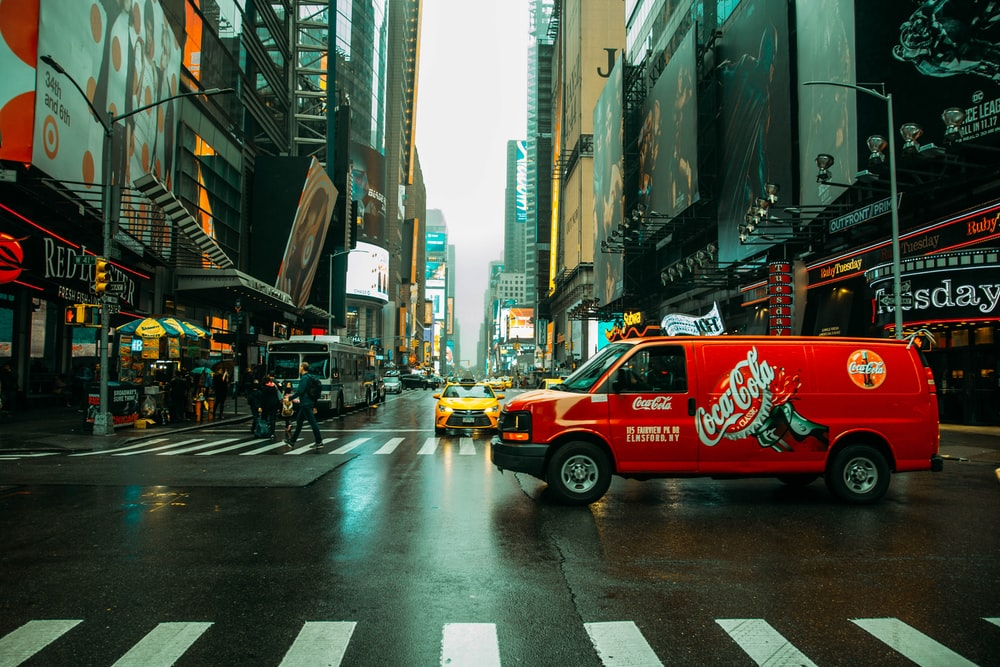 red and white coca cola truck on road during daytime