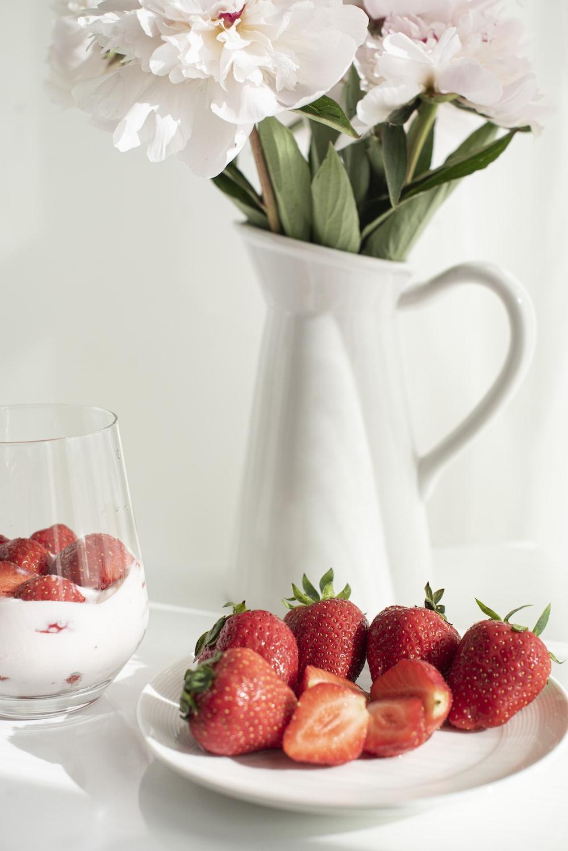 strawberries in white ceramic pitcher