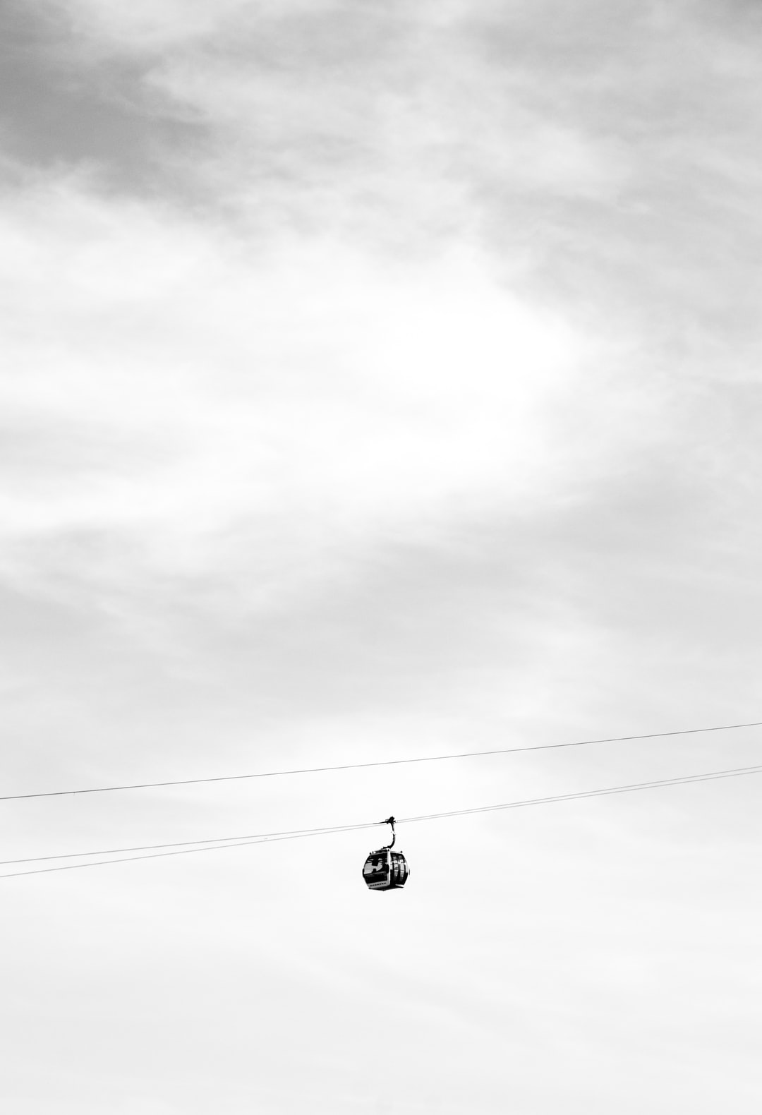 A cable car, part of the Emirates Air Line, makes its short journey over the river Thames.