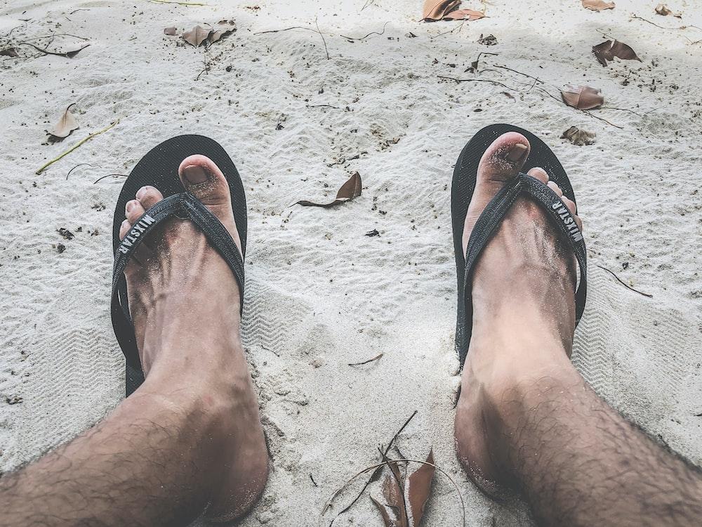 person wearing black flip flops