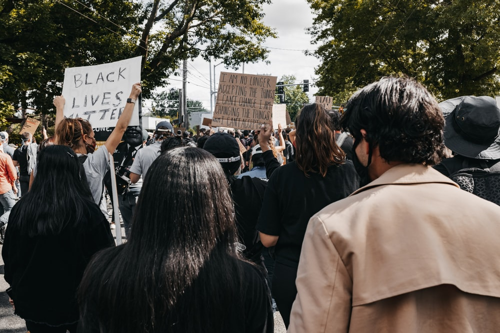 people gathering in front of brown building during daytime