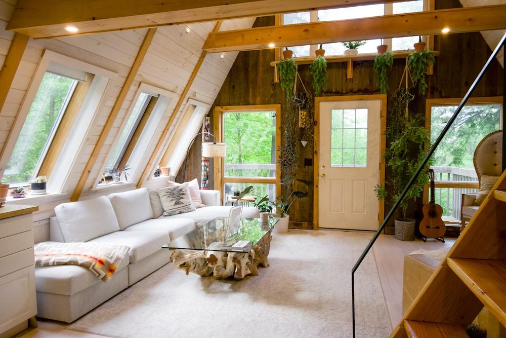 white sofa set near window