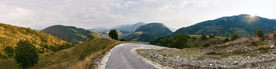 gray asphalt road near green mountains during daytime bosnia and herzegovina teams background