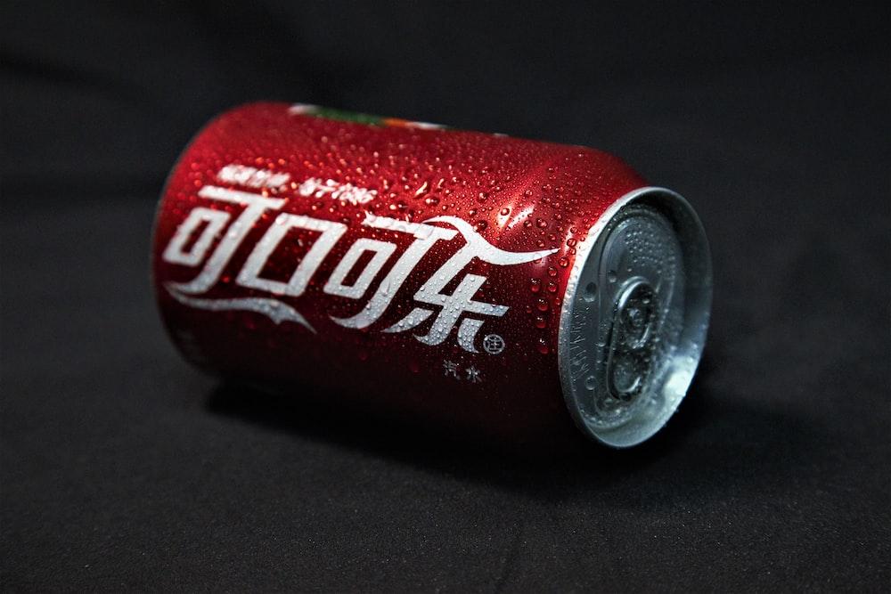 coca cola can on black textile