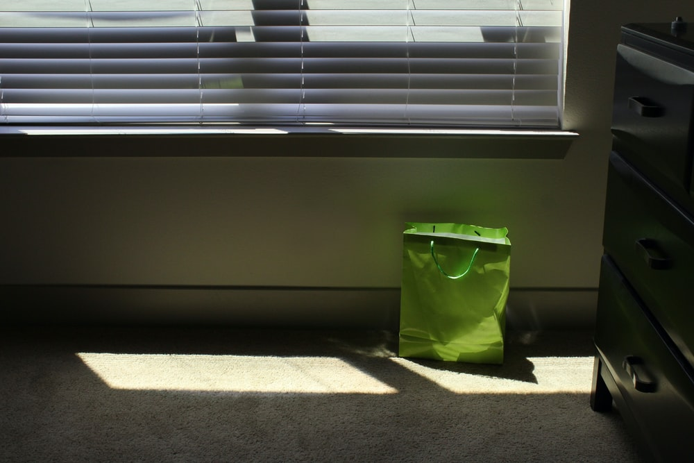 green tote bag on floor