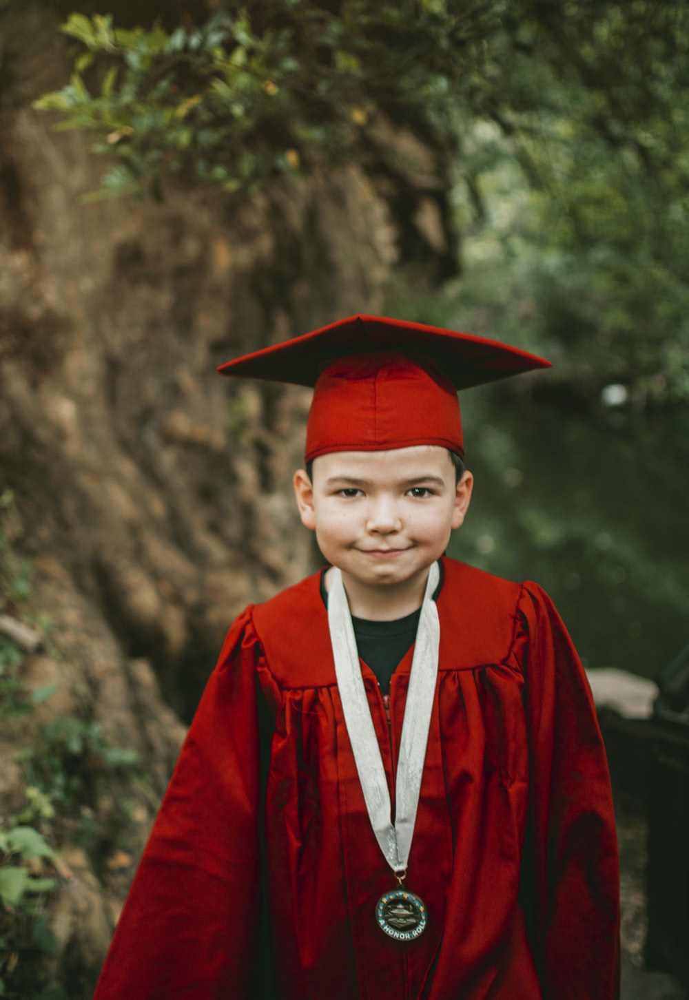 boy in red academic robe