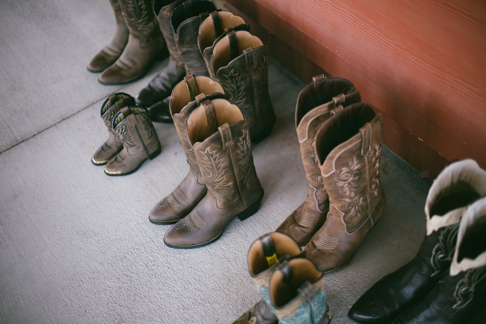 brown leather boots on gray carpet