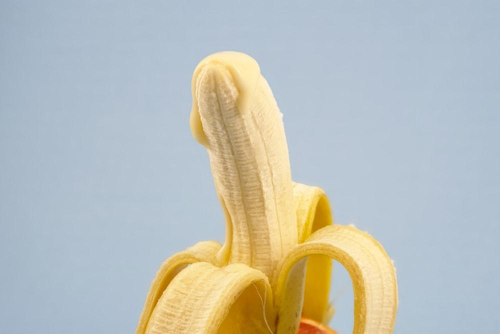 yellow banana fruit on white surface